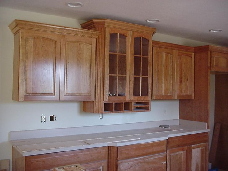 17 best images about crown molding over cabinets on for Attaching crown moulding kitchen cabinets