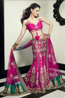 Flamboyant rani pink net lehenga choli