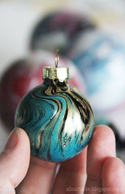 "Easy Marbelized Ornaments by alisaburke - Fill a container with about 2-3"" of water - mist the surface of the water with spray paint (outside!) - Add more colors - Let the colors blend together, shake or even stir to create swirls - Dip ornament & quickly remove. This tutorial is really for marbelizing paper, but you can use the same process on ornaments, and the color will dry to a permanent finish that won't peel or flake off."
