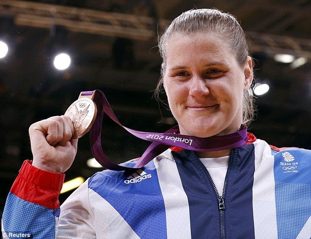 On the podium: Karina Bryant celebrates with her bronze medal in women's 78kg judo in the ExCel Arena today, just 24 hours after colleague Gemma Gibbons ended Britain's 12-year wait for an Olympic judo medal