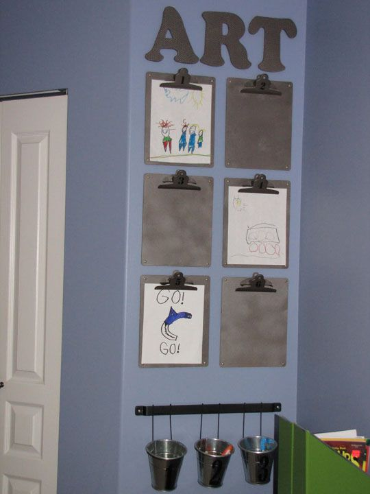 Clipboard Kids' Art Display ~ A perfect way to display all of your children's artwork.  Once school is in session you will be loaded with plenty.  Spray paint the clipboards with silver spray which gives it a simple industrial look.