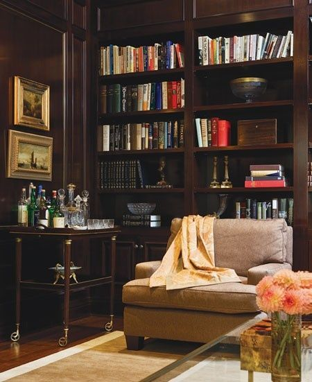 A traditional, wood-panelled library creates