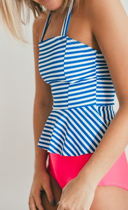 Blue Stripes and bright coral pink. Modest two piece swimsuit with high waisted bikini bottoms and a long peplum style top. Summer time nautical swimsuit look