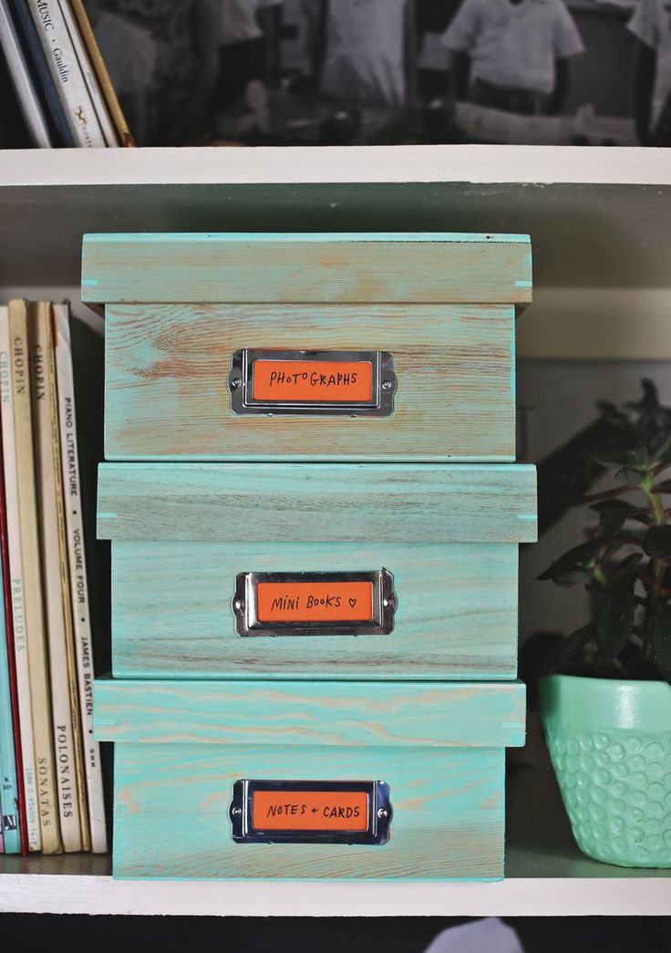 Today I'm continuing my organizing marathon with this little storage box set! They're super easy to make, lined with cute fabric and the perfect fit for our big bookshelf in our upstairs hallway. Supplies: Wooden boxes with lids, Martha Stewart wood stain in Beach Glass, brush, cotton rags, and printed cotten fabric for the box lining. 1. Pour some stain into a disposable container. Use your brush to paint the...