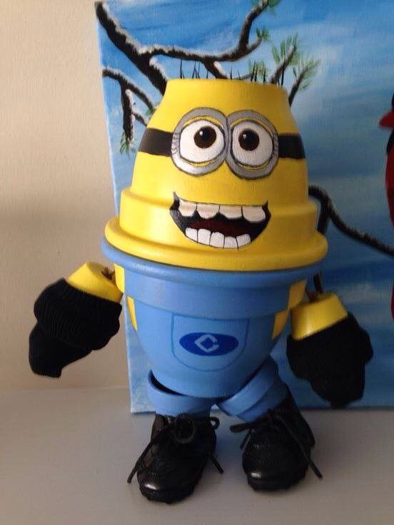 Minion out of clay pots.....adorable!