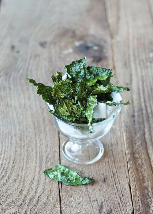 How to Make Kale Chips | follow recipe but spray with oil and cook in AIRFRYER for 8 minutes at 200degrees.Try spraying with sesame oil for a nice change. If you have the airfryer rack you can place it over the kale to stop it flying aroud during cooking.