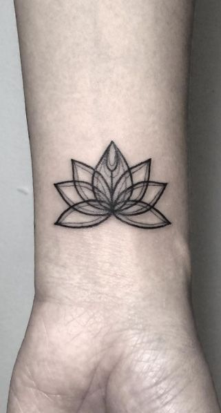 Lotus flower on wrist by Fin Tattoos