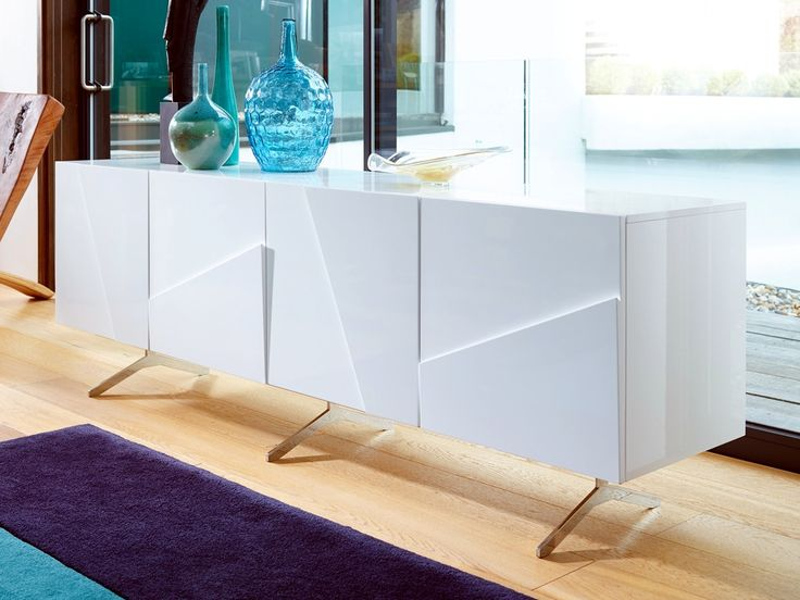 Gillmore Space Glacier Long Buffet Sideboard The high gloss white Glacier collection incorporates diagonal handles carefully bevelled into cabinet fascias creating unique light reflecting geometric surface textures.