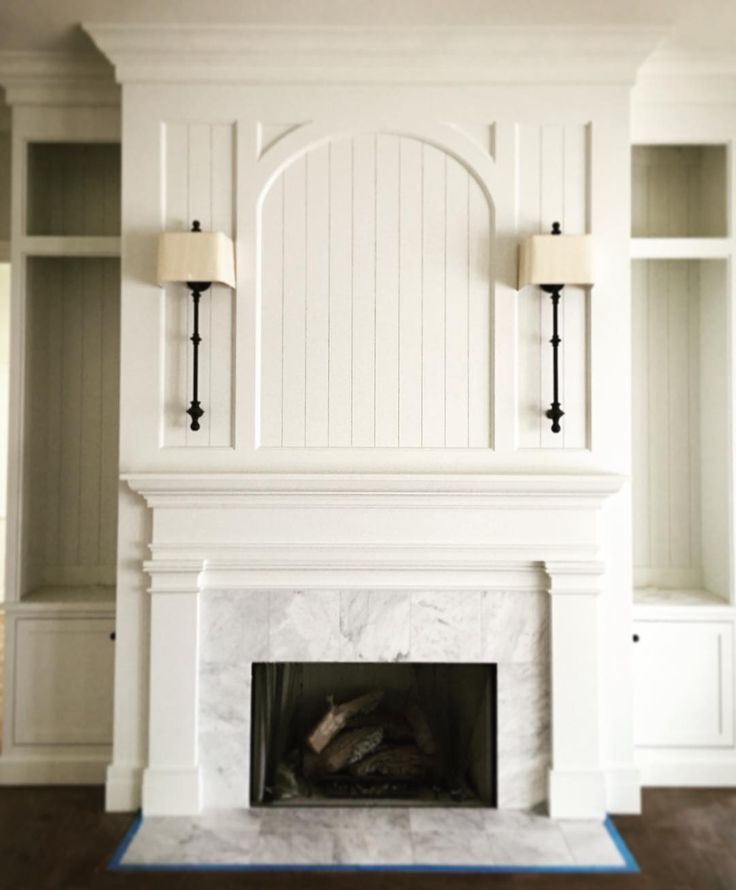 beautiful fireplace mantel stone and millwork love the creamy white on white
