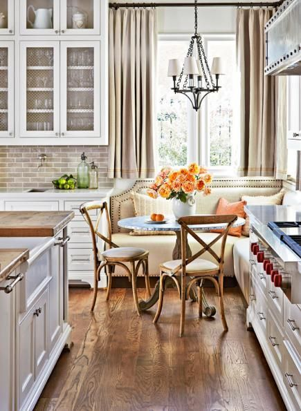 Kitchen banquette: If space is tight, opt for a pedestal table that leaves plenty of leg room. More ideas for banquettes: http://www.midwestliving.com/homes/decorating-ideas/6-ideas-for-kitchen-banquettes/
