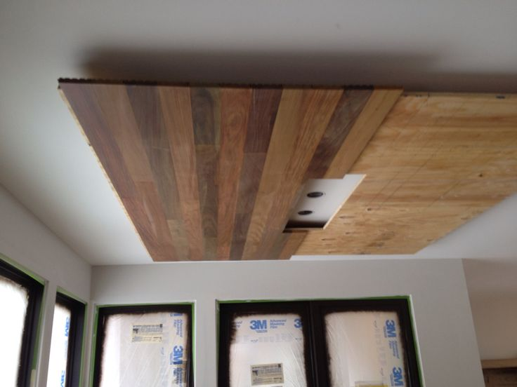 Ipe flooring attached to ceiling of a Golden Valley project by Bluestem Construction.
