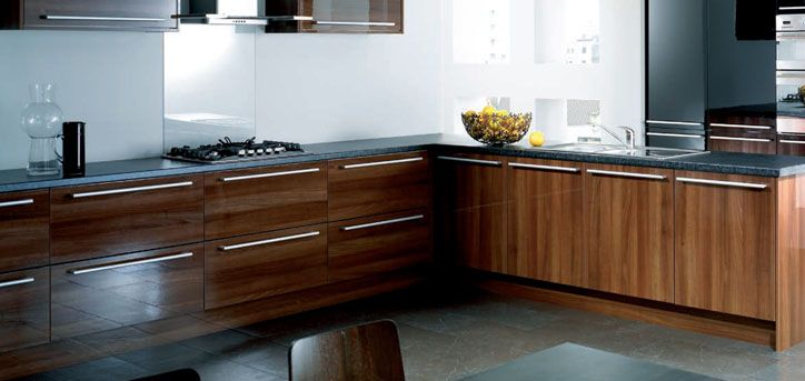 Reflections Walnut. Against all expectation I like this colour door. But with a pale floor and Butterum Granite top. maybe....