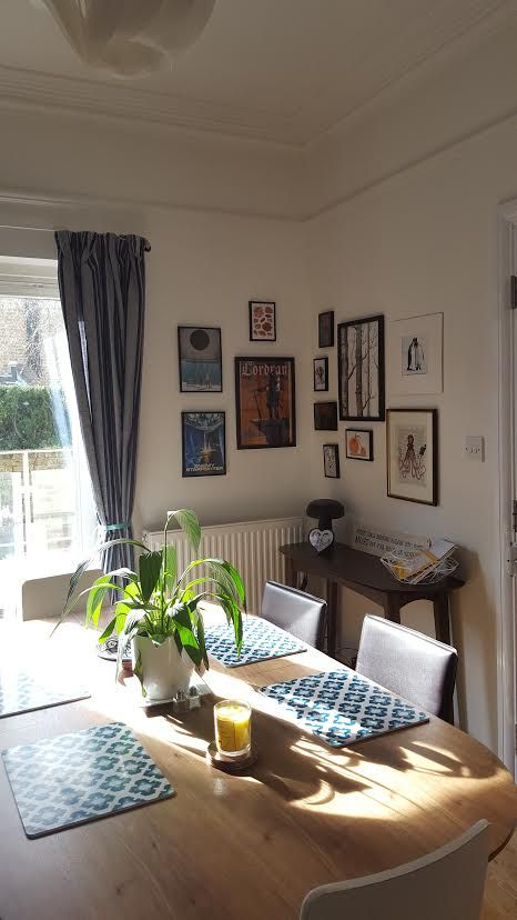 Dining area. Dulux Timeless walls, gallery wall, MADE Edelweiss dining table.