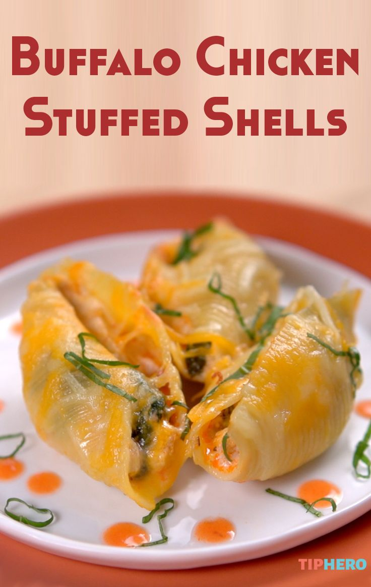 Buffalo Chicken Stuffed Shells Recipe | A spicy version of the classic Italian stuffed-shells featuring a blend of Buffalo chicken, ricotta cheese, and even some spinach for good measure, topped off with even more cheese for a dish that's as perfect for Sunday dinner as it is for the Sunday game. Click for the video and recipe and give it a try!  #familydinner #gamenight #homecooking #dinnertime #yum