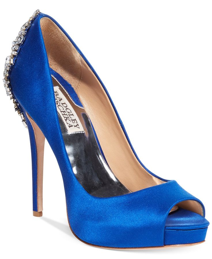 A bridal shoe that looks fierce from the front and back? Yes, please! Badgley Mischka's blue satin platform pumps has a gorgeous jeweled heel, perfect for making a statement as you make your way down the aisle.