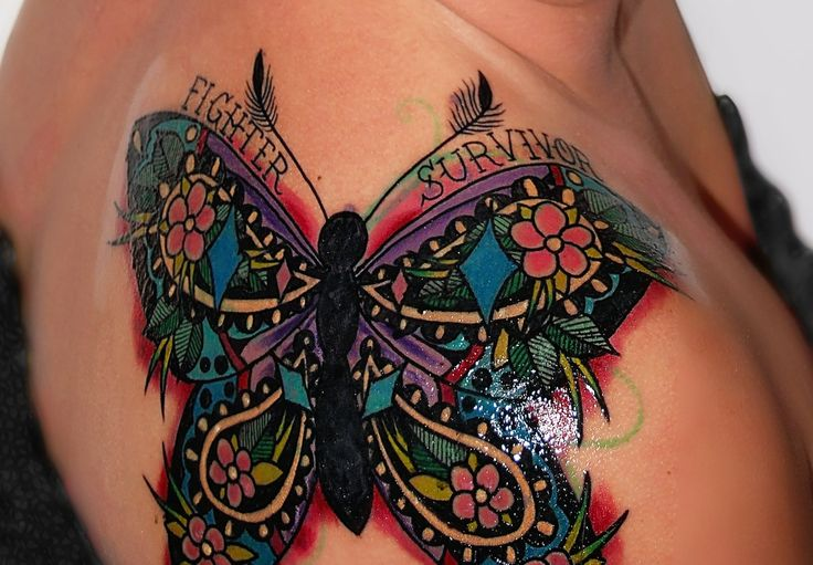 My gorgeous thyroid cancer survivor tattoo! The butterfly is the symbol for thyroid cancer with colors of pink, purple and teal. I couldn't be happier! Artist: Matthew Kurth at Spirit House Tattoos in Beaumont, TX.