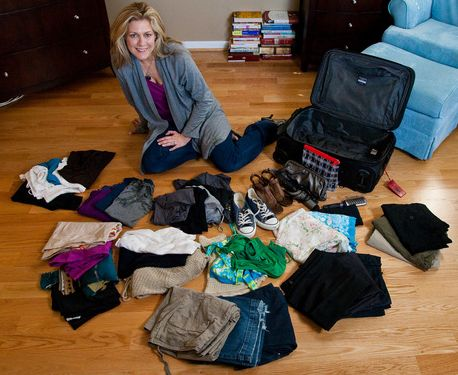 a flight attendant demonstrates how to pack enough for a 10-day trip into a single standard carry-on
