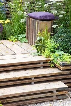 Wooden deck and stairs made from old scaffolding planksI like the bench!