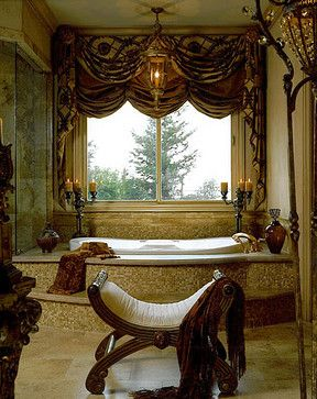 Maria Billingsley of J Hettinger Interiors. Rich jewel tone colors...letting full sun into the window...love the chair in the center of the room and the shower at the foot of the tub.  Tuscan feel.