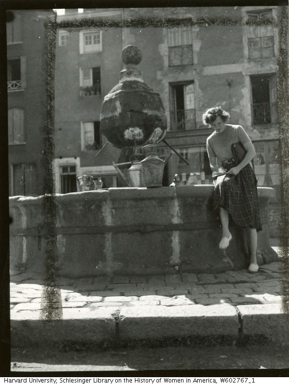 Julia Child at La Chaise Dieu seated outdoors writing postcards, 1949, Paul Child | Schlesinger Library