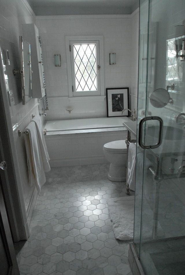 Tudor revival bathroom - Home Decorating & Design Forum - GardenWeb: sayde bathroom, large hex tiles---well designed mix of old and modern elements.  Don't really like the floor tiles, but the rest is really nice. :)