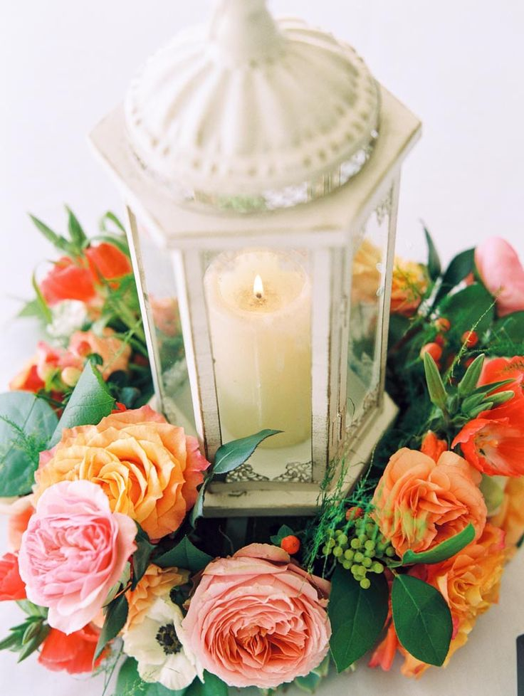 Lantern centerpiece with flower wreath