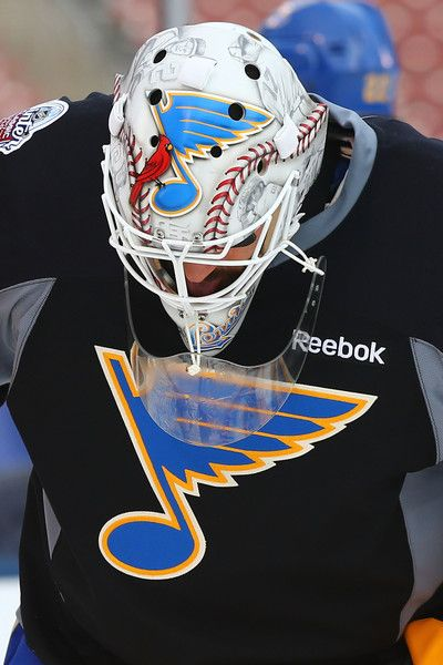 Carter Hutton #40 of the St. Louis Blues wears a helmet specially made to commemorate the 2017 Bridgestone NHL Winter Classic during the 2017 Bridgestone NHL Winter Classic Practice Day at Busch Stadium on January 1, 2017 in St. Louis, Missouri.