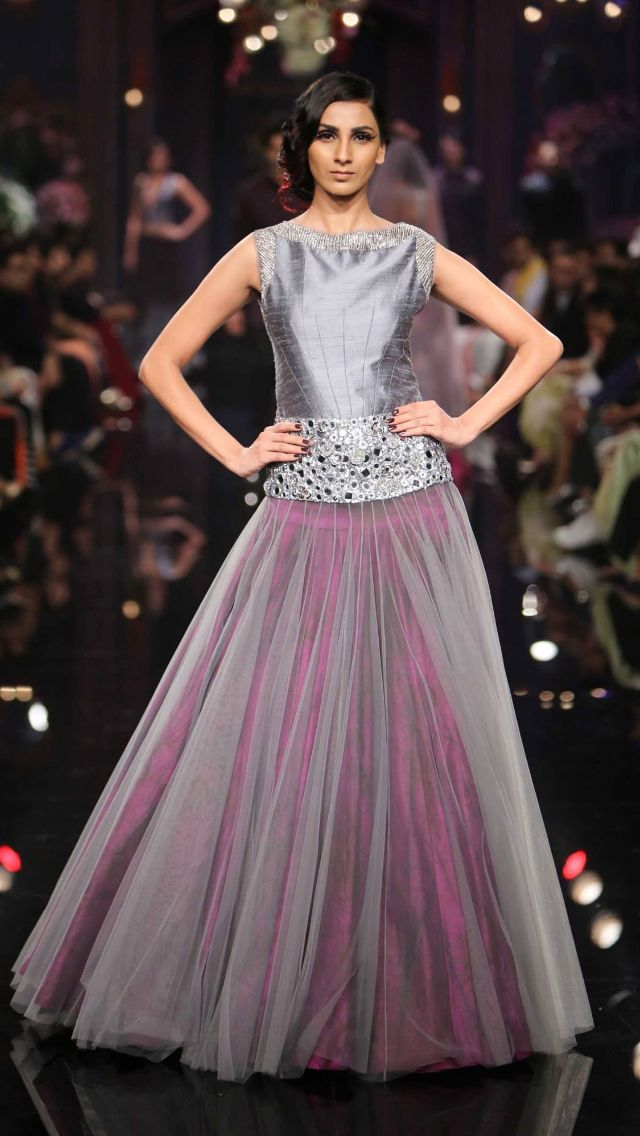 grey net / chiffon / taffeta over pink but a softer pink I think. And the solid grey bodice is too harsh.