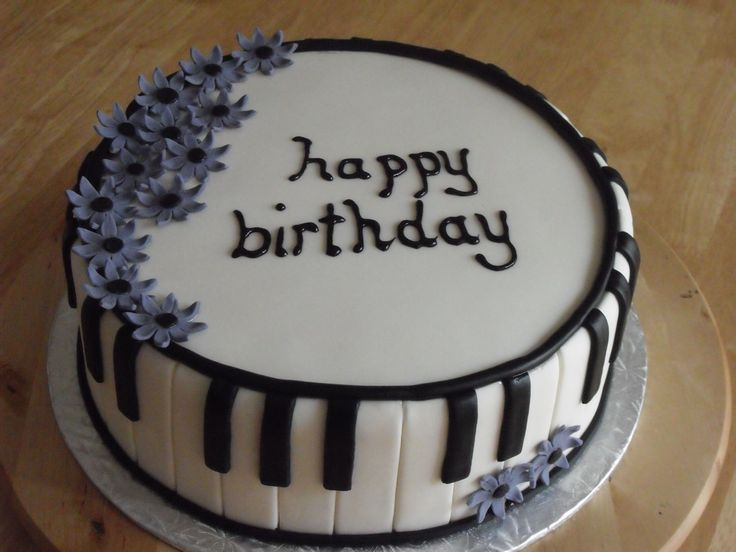 "- a piano themed cake.... I way really happy with this cake. Although, I hate writing on cakes - need lots of practise there.  Lots of inspiration from similar cakes here on CC... thanks!  10"" double chocolate filled w/ choc. ganache and vanilla b/c, covered in mmf, all decorations in mmf. TFL"