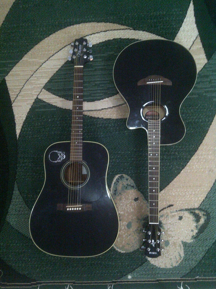 mine is the right one, Yamaha APX500II. how i love you my sweet black soulmate :*    oh yeah that big one on the left is Ivan's guitar..