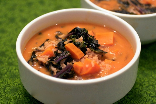 vegan red curry soup with brown rice and purple kale