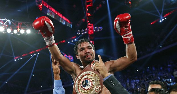 Manny Pacquiao, from the Philippines, raises his arms while wearing the champion's belt as he celebrates winning his WBO international welterweight title fight against Brandon Rios of the United States, Sunday, Nov. 24, 2013, in Macau. Pacquiao defeated Rios by unanimous decision on Sunday, returning to his winning ways after consecutive losses. (AP Photo/ Vincent Yu)  http://globenews.co.nz