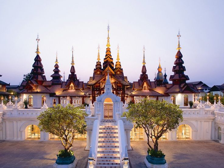 Why we love it: The spa and wellness center at Dhara Dhevi Chiang Mai is reason enough for guests to travel 20 minutes outside Chiang Mai, but supreme pampering extends to all guests on this 60-acre compound. The resort's pagoda-like design—towering gilt spires and elaborate, well-tended gardens—evokes the Thai villages of old. The rooms are regal to match, with hand-carved armoires, and Thai silks draped over chairs. As for the food, sample northern and central Thai cuisine at Le Grand Lann...