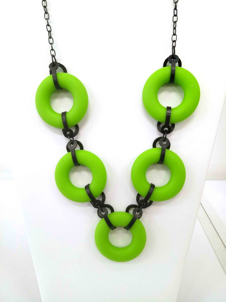 JakDesigns - A stunning necklace constructed of  lime green circles and black shapes $60