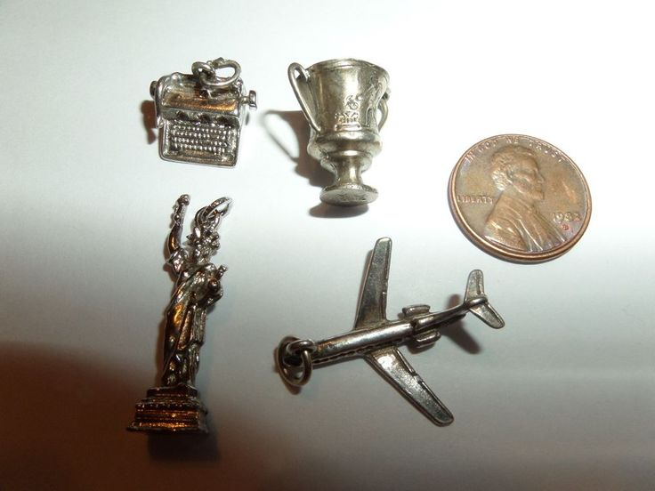 4  SILVER CHARMS FROM ESTATE AUCTION TYPEWRITER, CHALICE,STATUE OF LIBERTY,PLANE #Unbranded
