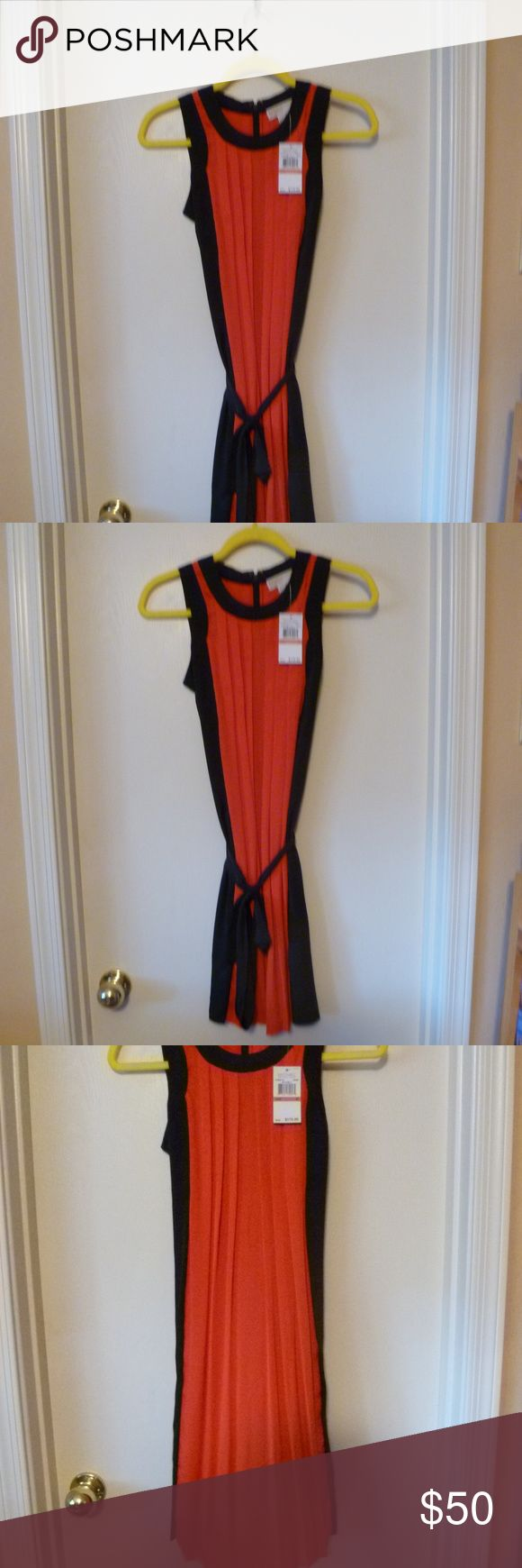 Mickael Kors Petite Dress Cherry NWT Michael Kors size P2 dress.  It's a cherry orange and navy blue.  100% Polyester  Dry clean only.  This is brand new never worn and it's really beautiful. Michael Kors Dresses Midi