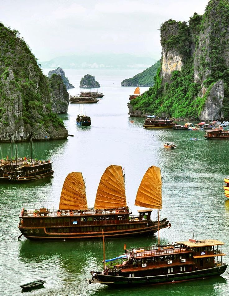 Tourist Junks and Floating village in Halong Bay, Vietnam