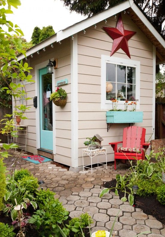 im in love i want my own little studio in my backyard white window and frame work off pink house teal blue door and window box red wood chair plants cozy