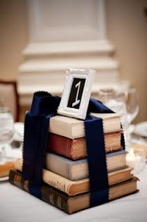 Centerpiece: Painted books, painted to match, with a short vase of flowers atop.