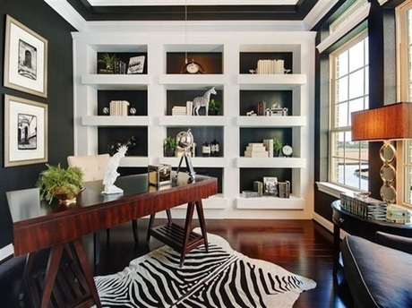 A zebra-print rug and black and white color scheme create complement the wood floors and desk, creating a chic and sophisticated feel. The Capriccio model by Ryland Homes at Northlake at Gleannloch Farms 80's, near Houston, TX.