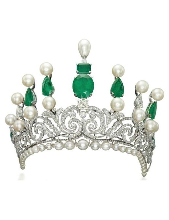 AN IMPRESSIVE BELLE EPOQUE EMERALD, NATURAL PEARL, CULTURED PEARL AND DIAMOND TIARA. The Belle Epoque diamond-set scroll tapering bandeau on a later added base of graduated cultured and natural pearls with diamond rondelle spacers, to the later added graduated bar surmount set with cultured and natural pearls, emeralds and diamonds. #BelleÉpoque #tiara