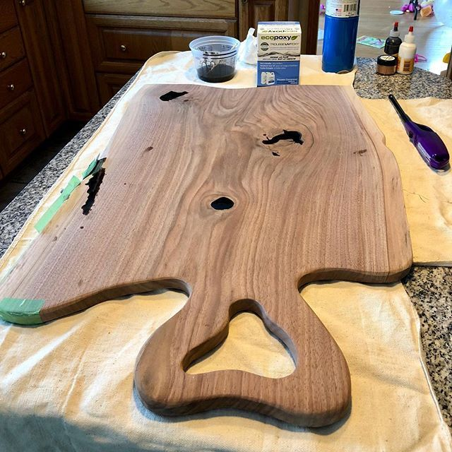 Trying a new charcuterie board style inspired by @rustic_designs_by_rich. Just filled the knots with @ecopoxy and tinted it with black pigment. Will be able to clean the board up tomorrow and hit it with oil.