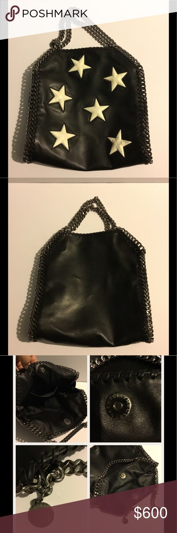 "Stella McCartney Black-white Falabella mini star shoulder bag. Faux-Leather polyvrethane-polyester w-star appliqués on Front. Signature chain-whip stitch trim. Top handles, approx 4.5"" drop, hanging logo disc charm. Chain shoulder strap, button closure, inside fabric lining, one open pocket. 10""H 10""W 4"" D Made in Italy PLEASE NOTE AS YOU MAY SEE ON LAST PHOTO IT HAS ON THE STARS A BIT STAIN. I DINT KNOW THEY THEY DID. No dust bag or box. Over all in good condition. Online Sold Out. PRICE…"