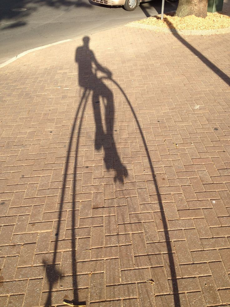 Penny Farthing shadow. The race is only ever with yourself.