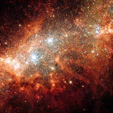 Galaxy NGC 1569. Image and text copyright © Astrographics. All rights reserved. Image courtesy of Space Telescope Science Institute.