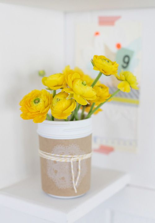 adorable use of plastic containers - painted, labeled and tied with bakers twine. Love the neutral sleeve with the pop of yellow in the flowers
