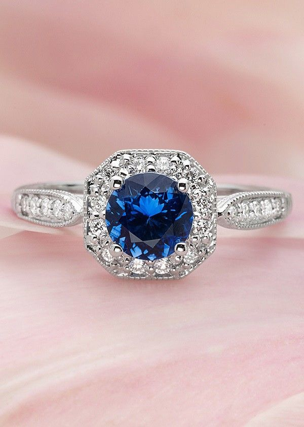 The diamond accents and milgrain detailing give this sapphire ring a truly vintage feel.