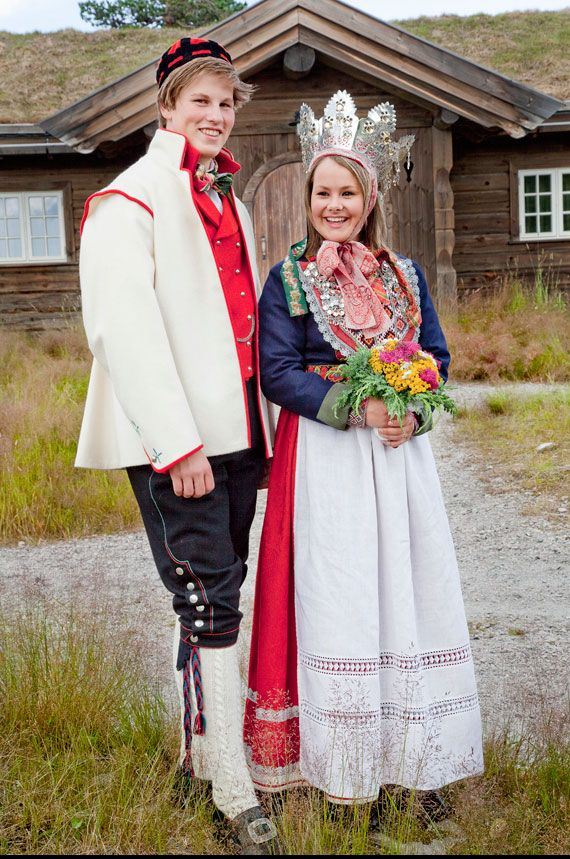 Europe | Portrait of a couple wearing traditional wedding costumes and bridal crown, Norway
