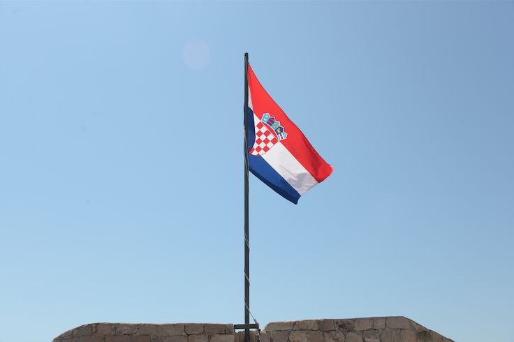 Croatian flag on the old town city walls of Dubrovnik, Croatia