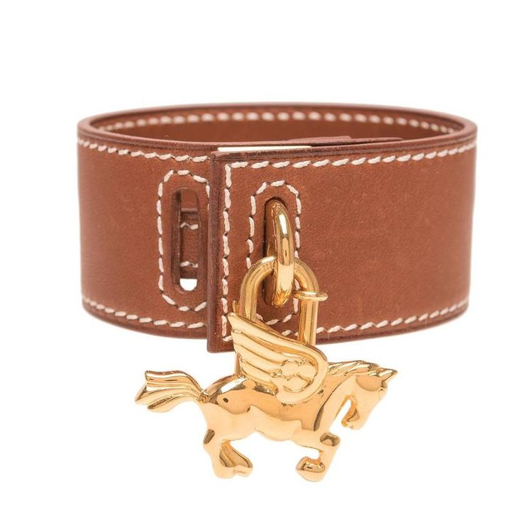 Hermes Gold Barenia Leather Bracelet with Gold Pegasus Charm | From a unique collection of vintage cuff bracelets at https://www.1stdibs.com/jewelry/bracelets/cuff-bracelets/